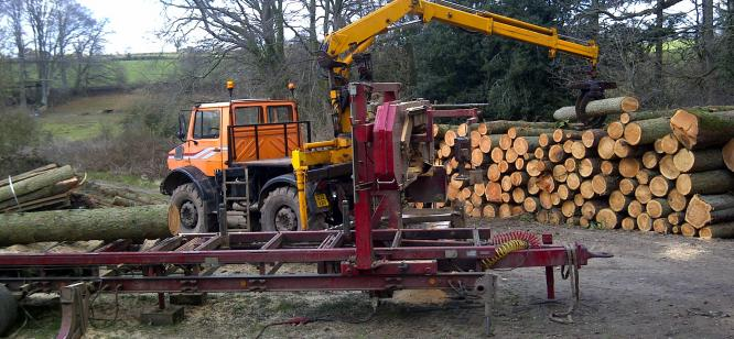 The Serra mill being loaded by Unimog at Escot Park Devon